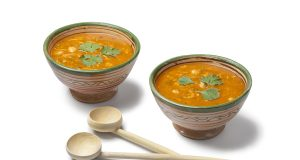 Moroccan harira soup in traditional bowls and wooden spoons